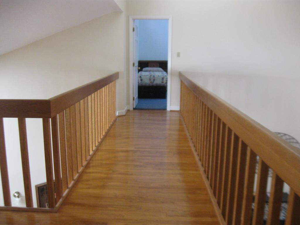 Catwalk with hardwood flooring